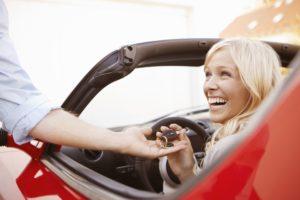 girl-receiving-keys-to-an-electric-car-108356531-57aaad255f9b58974a5d3d77
